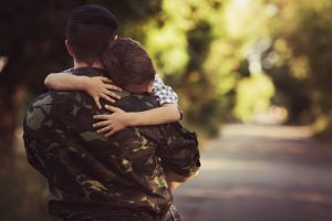 Little boy and soldier in a military uniform
